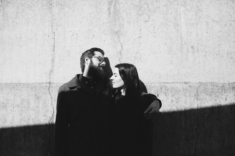 A black and white portrait of an engaged couple outside the turner Contemporary Art gallery in Margate having their Kent engagement shoot by Matilda Delves Wedding photography