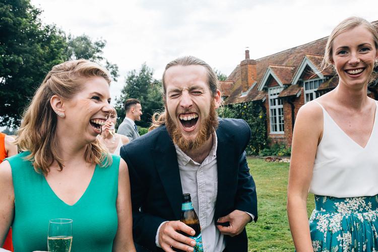 Fun wedding photographer Kent - Kent Documentary wedding photography - Back garden marquee wedding Canterbury