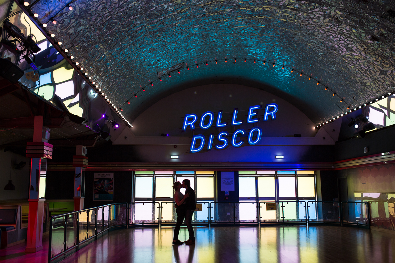 A couple kissing on the roller disco dance floor in Dreamland Margate