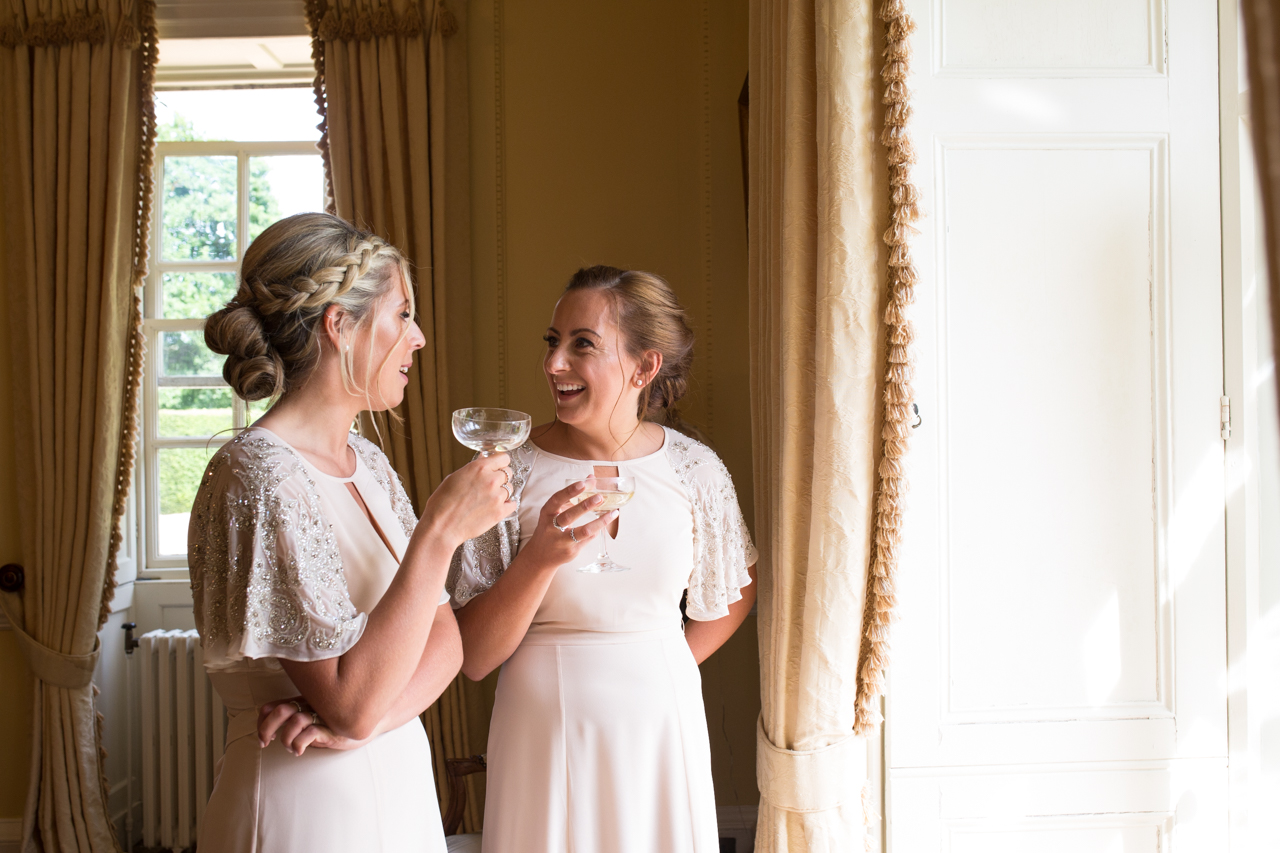 A colour photography of a bridesmaids at Sprivers Mansion -Kent documentary wedding photography