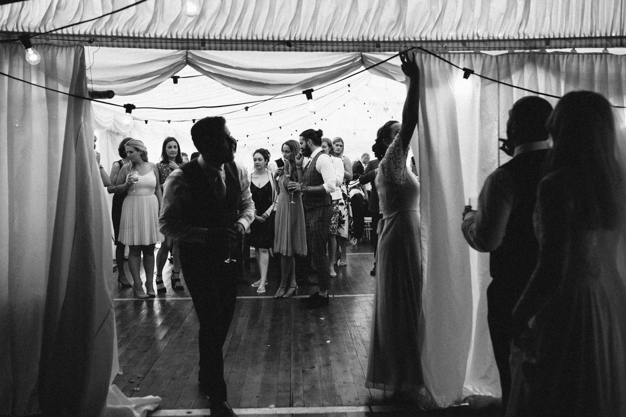 A black and white photography of wedding guests just before the first dance at Sprivers Mansion
