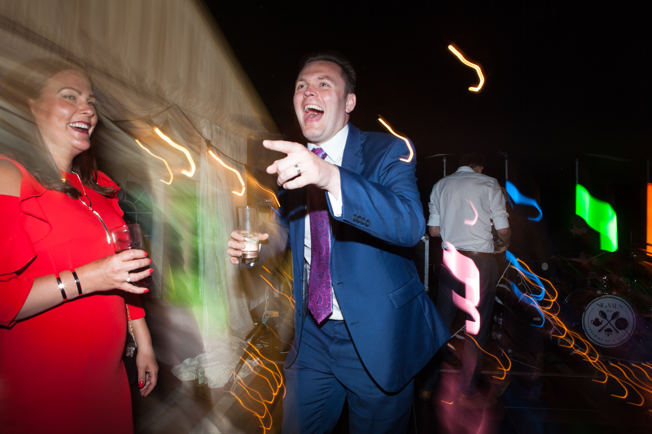 Fun dancing photos of a wedding guest -Kent documentary wedding photography