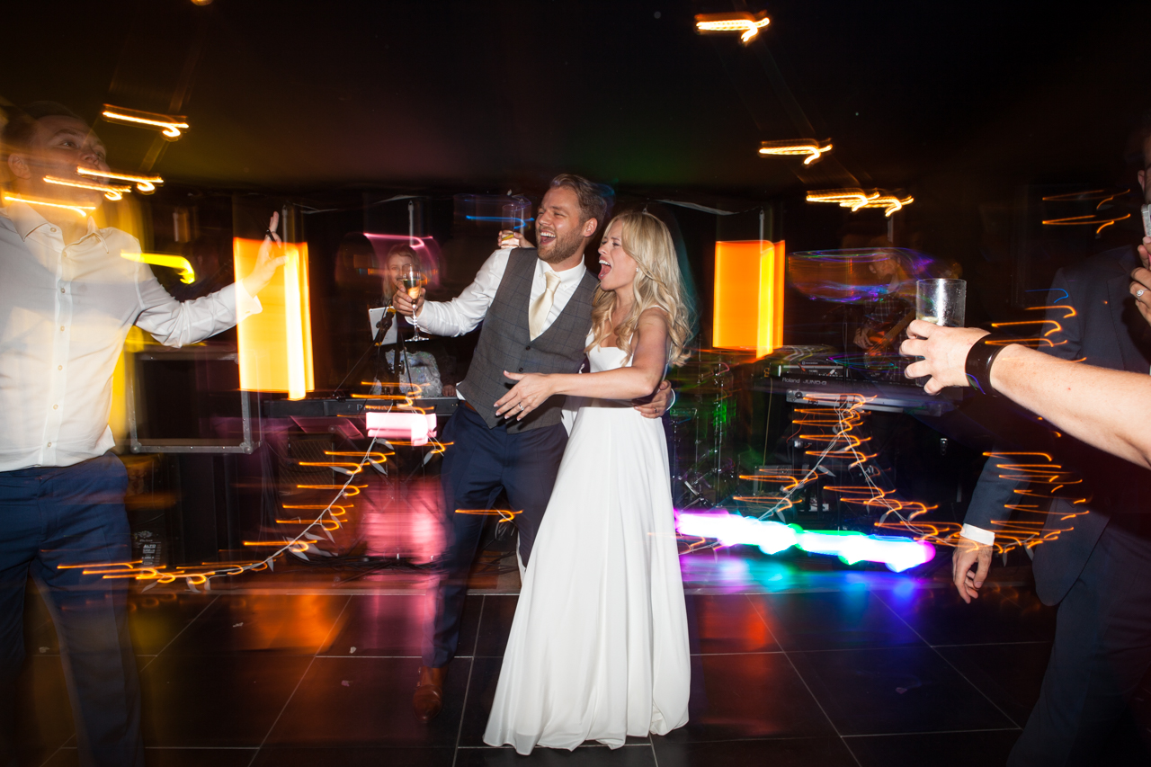 A fun colour photograph of a bride and groom on the dance floor at Sprivers Mansion