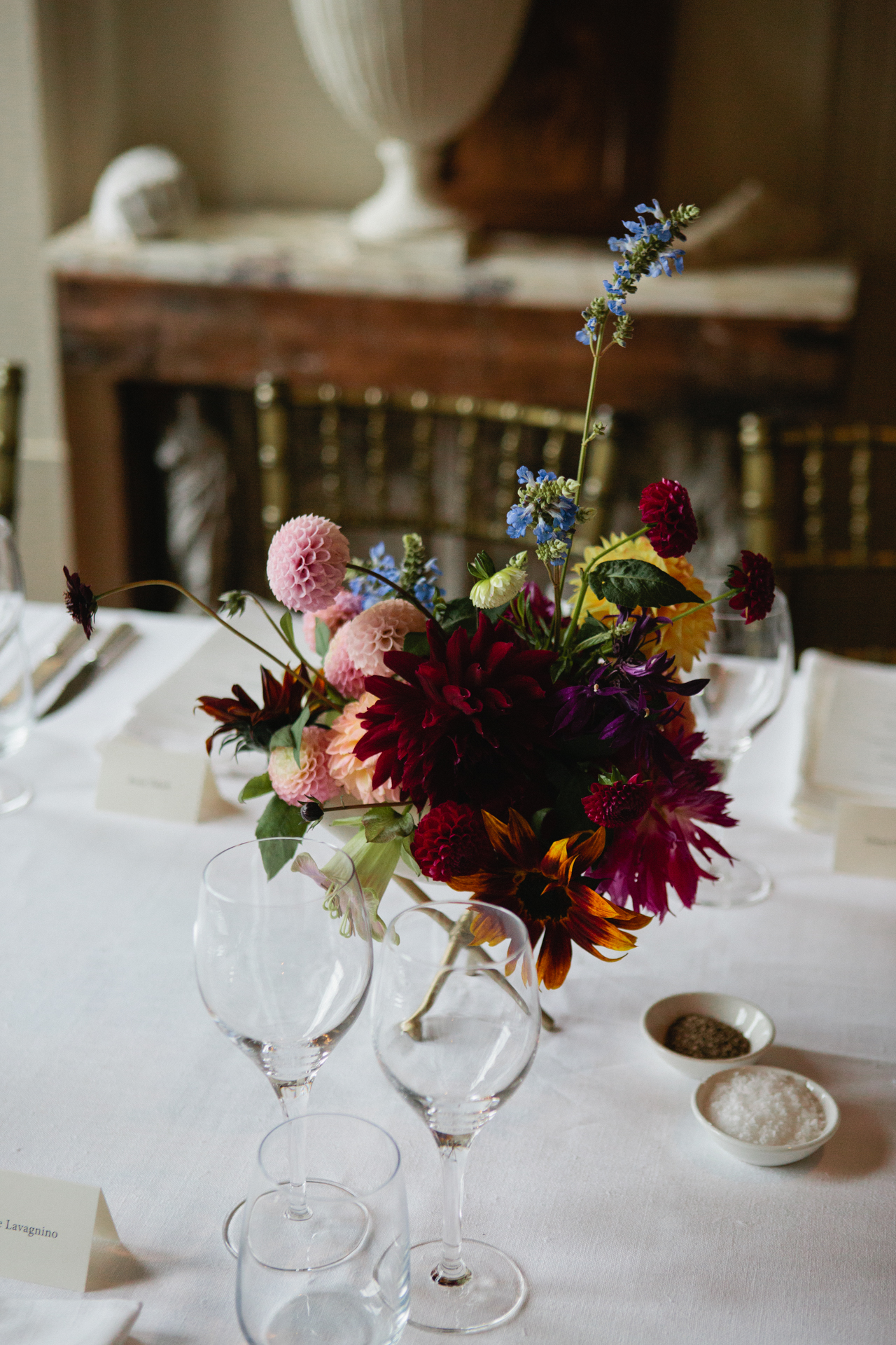 An autumnal flower display on a table at Aynhoe Park