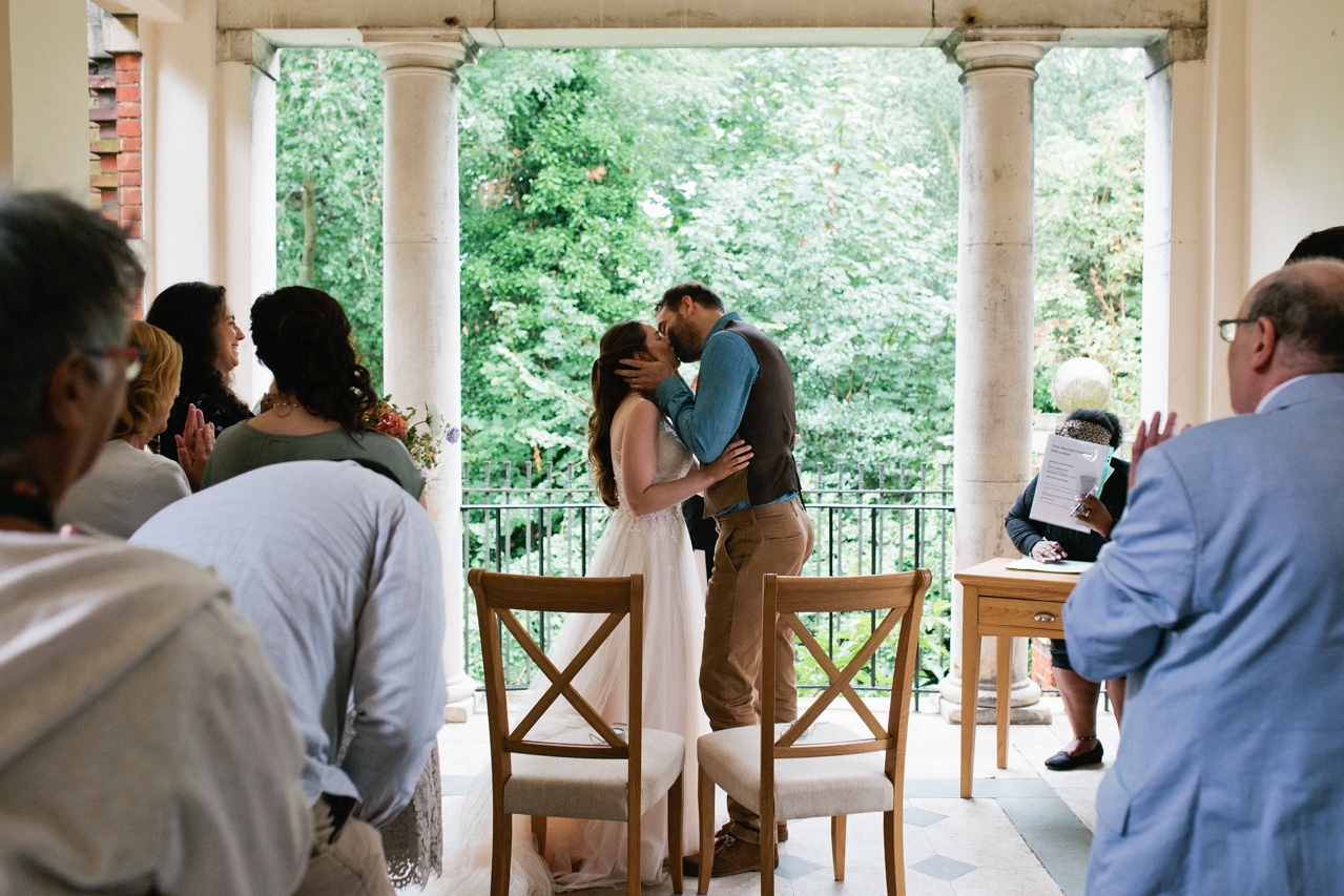 First kiss at London weddding at The Hill Top Gardens and Pergola Wedding on Hampstead Heath - Kent documentary wedding photography