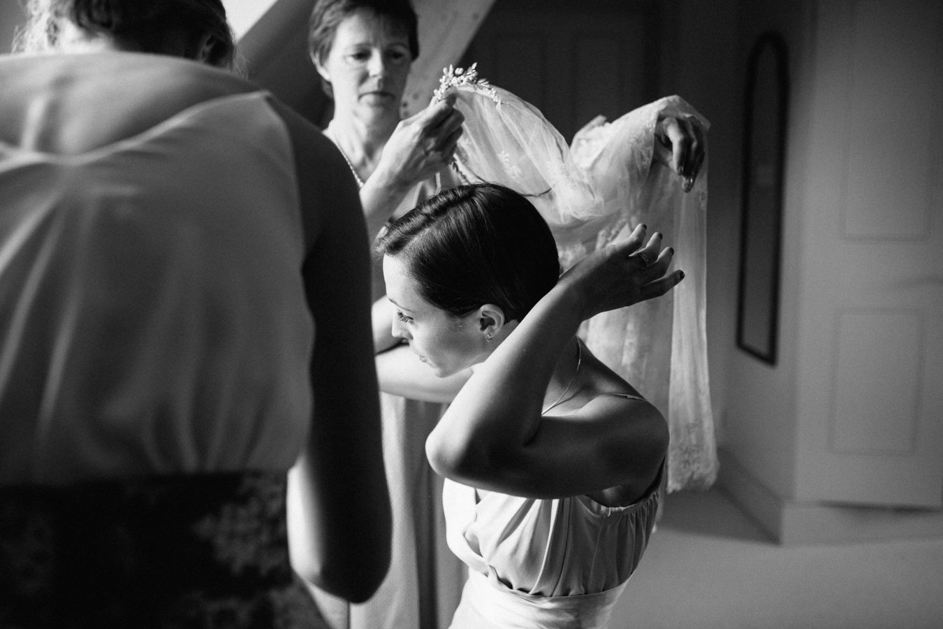 A black and white portrait of a bride getting ready before her beautiful marquee wedding photographed by natural Kent Documentary wedding photographer Matilda Delves