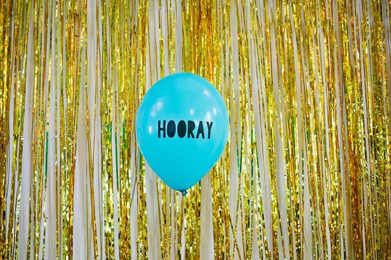 Hooray ballon with a gold foil backdrop at a funky hipster wedding in Hythe kent