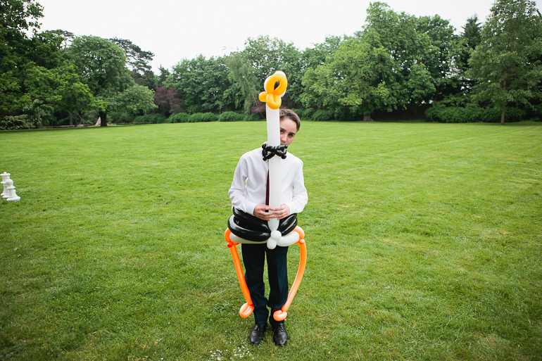 A young wedding guest with the most amazing balloon animal at Woodlands Park Hotel in Surrey