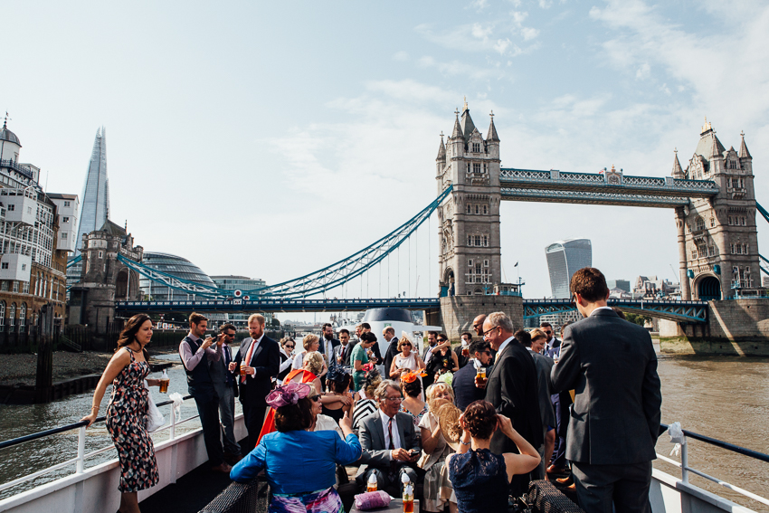 Wedding guests on board the top deck of The Erasmus durring a Thames Barge London Wedding