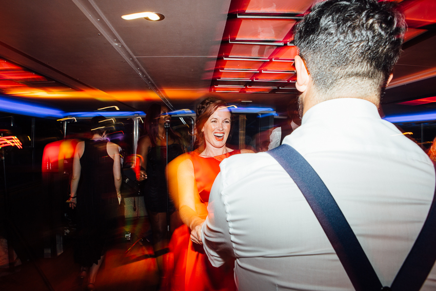 Wedding guest dancing on The Erasmus Boat at a Thames Boat Wedding