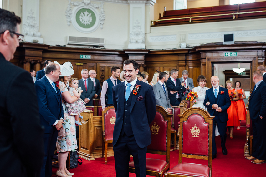 Groom waiting for his bride in Islington Town Hall