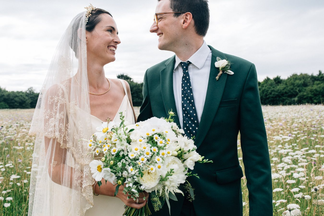 A bride and groom lovingly look at each other during their beautiful marquee wedding reception photographed by natural Kent Wedding photographer Matilda Delves