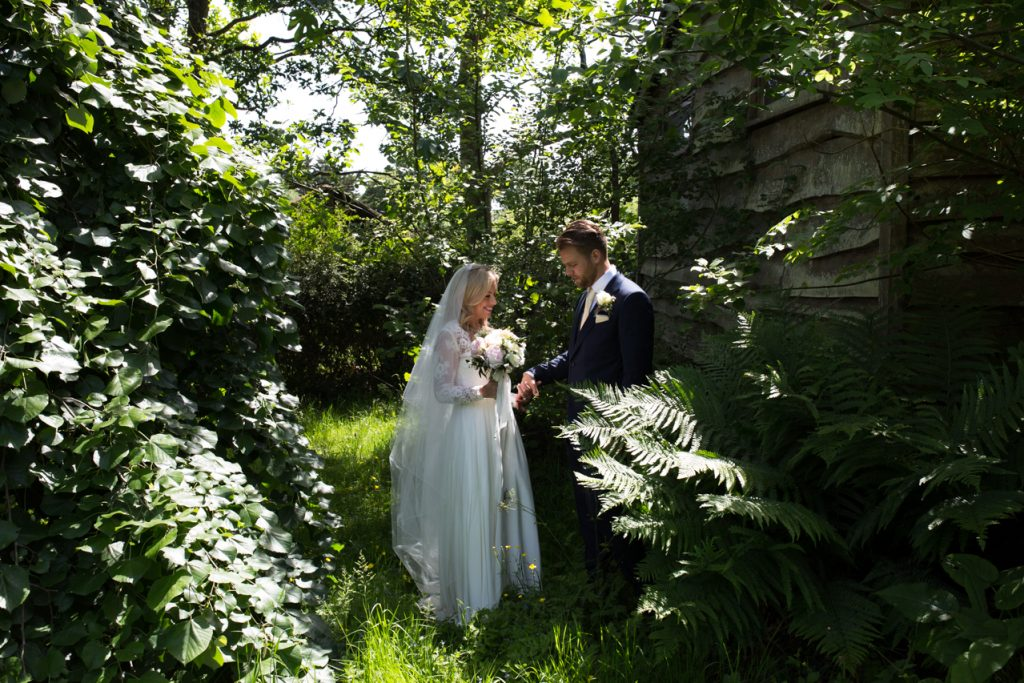 A portrait of a bride and groom in the summer light by Kent wedding photographer Matilda Delves