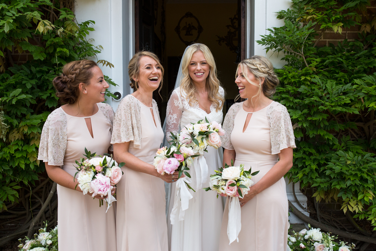 A colour photography of a bride and her bridesmaids at Sprivers Mansion -Kent documentary wedding photography