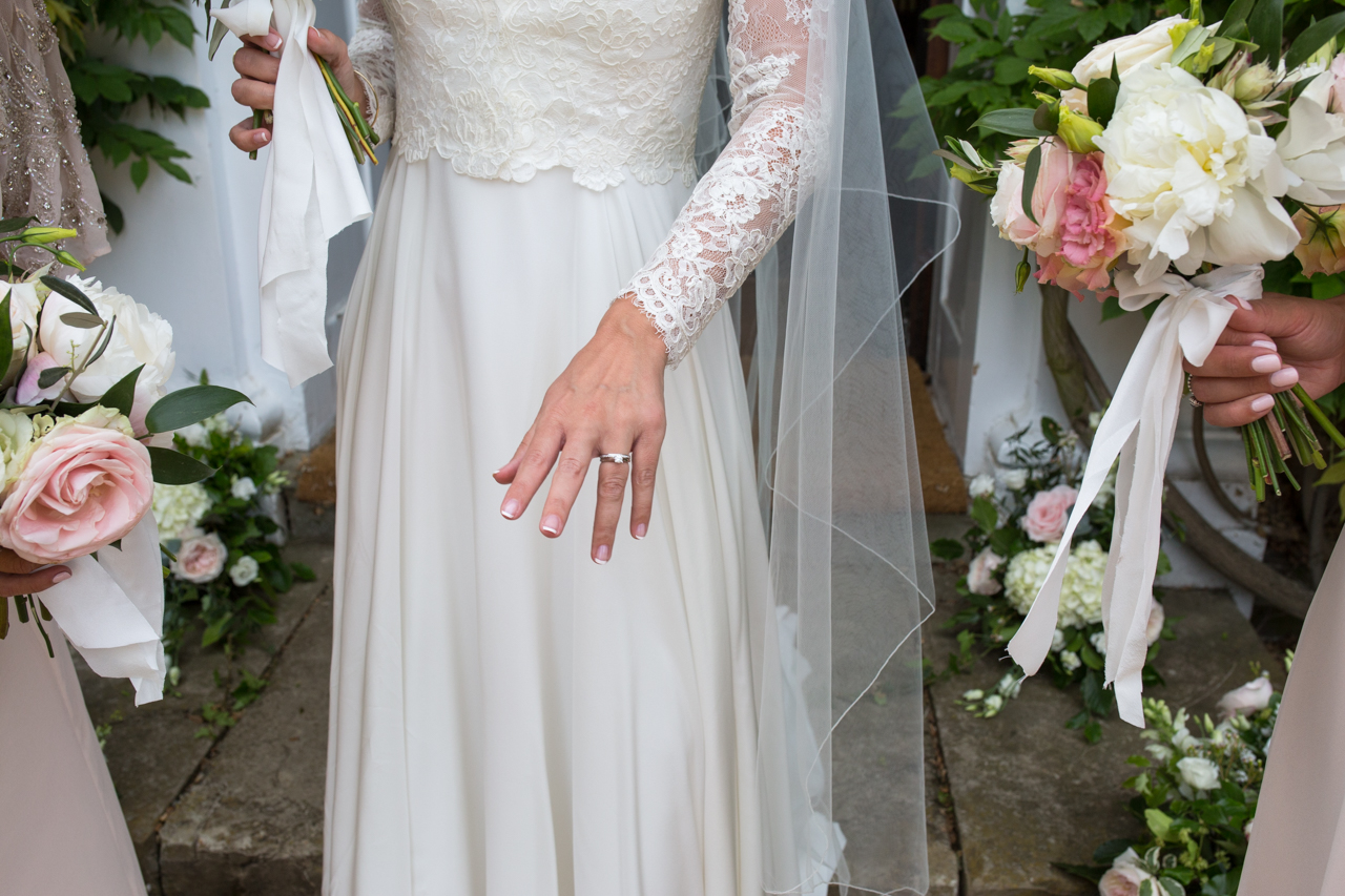 A pretty colour photography of a bride and bridesmaids at Sprivers Mansion -Kent documentary wedding photography