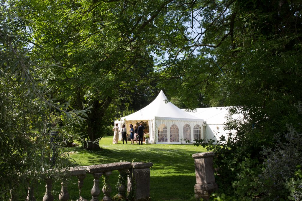 A white marquee tent set up for a wedding at Sprivers Mansion on a summers day
