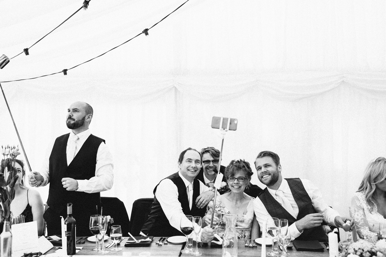 A black and white photography wedding guest take selfies at Sprivers Mansion