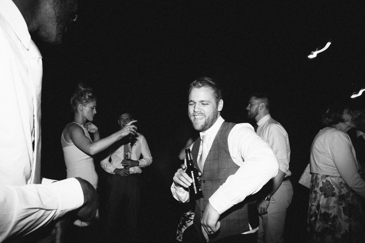 A black and white photography of a groom on the dance floor at Sprivers Mansion