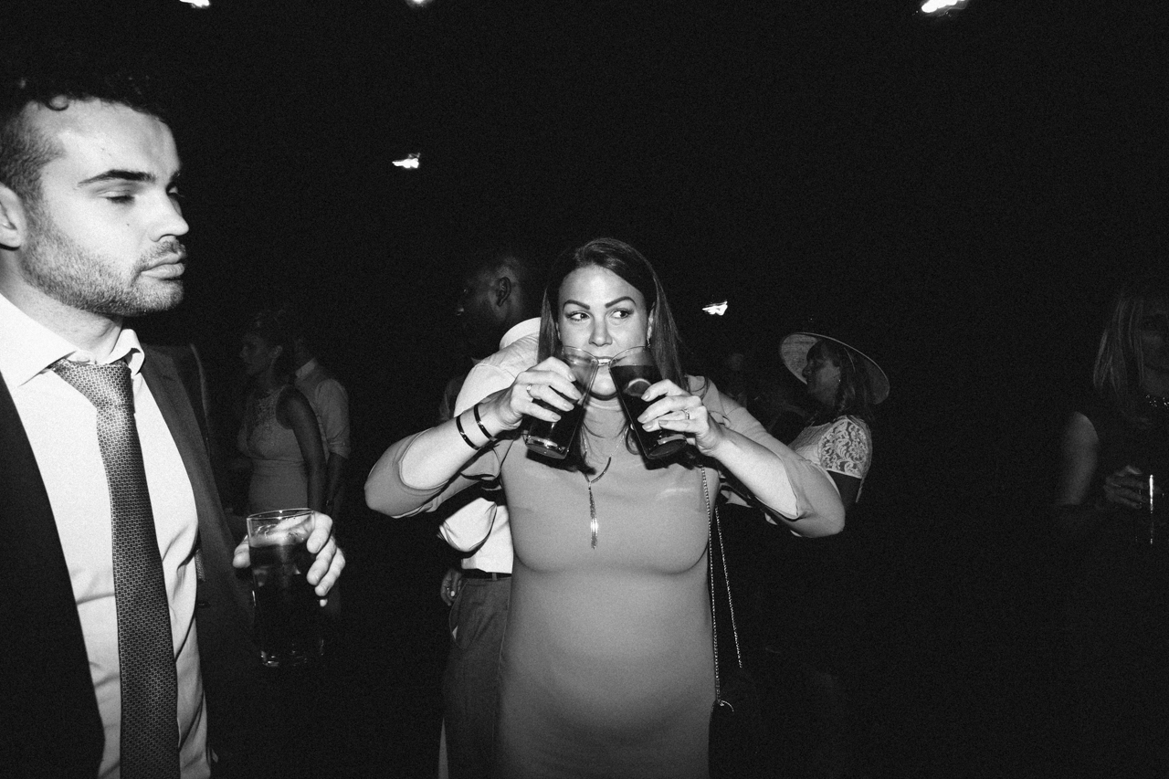 A humorous black and white photography of a wedding guest at Sprivers Mansion