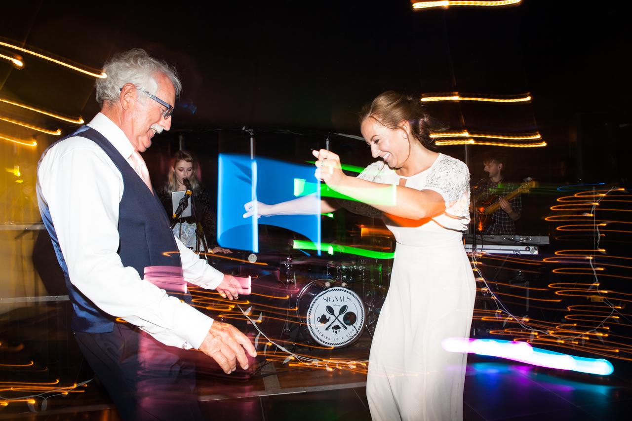Fun dancing photos of a wedding guest -Kent documentary wedding photography