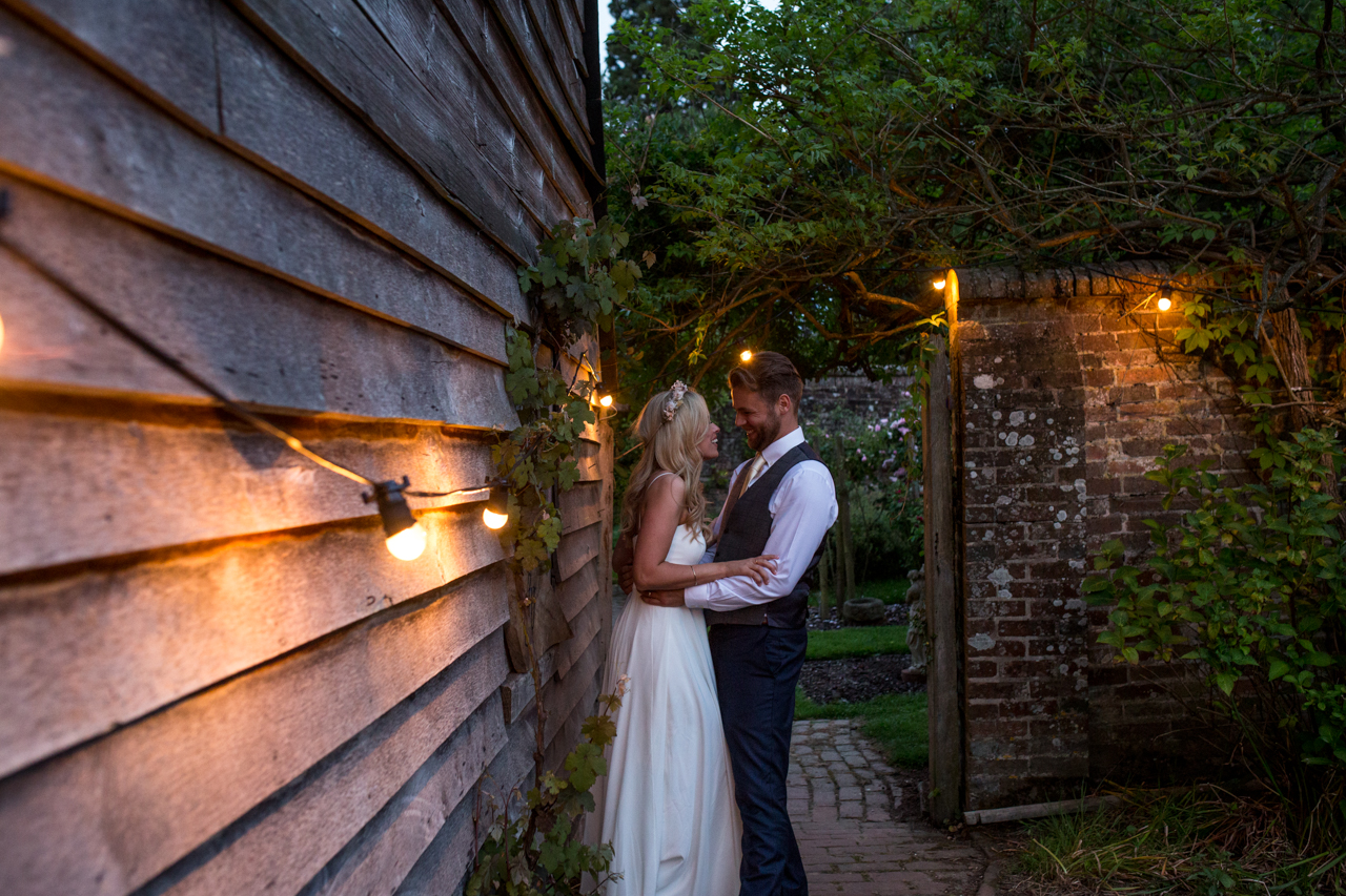 A bride and groom kissing in the eveing at a wedding at Sprivers Mansion