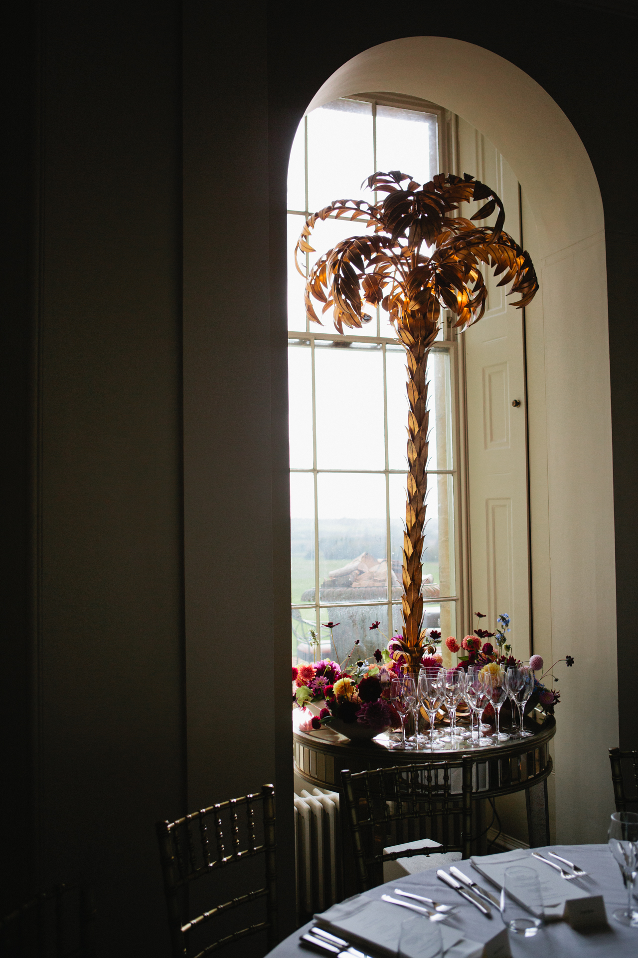 Aynhoe Park decorated with gold palm leaf lamps