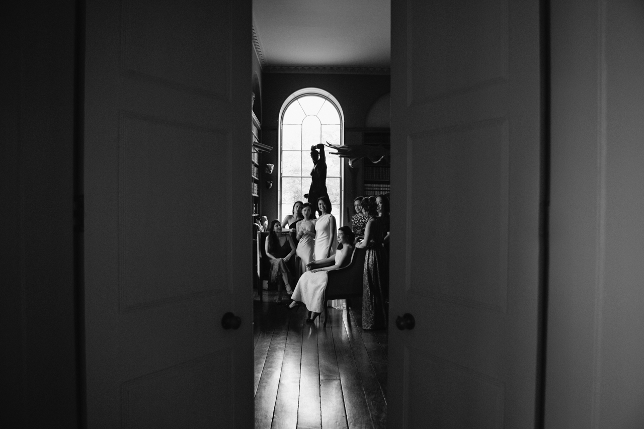 A bride and her bridesmaids looking like a vanity fair magazine cover at Aynhoe Park wedding venue
