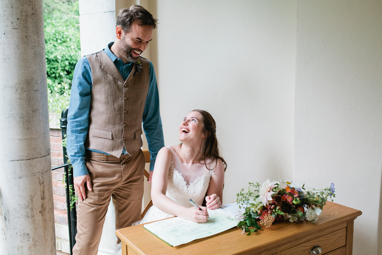 The signing of the registry at a civil ceremony at The Hill Top Gardens and Pergola Wedding on Londons Hampstead Heath - Kent documentary wedding photography