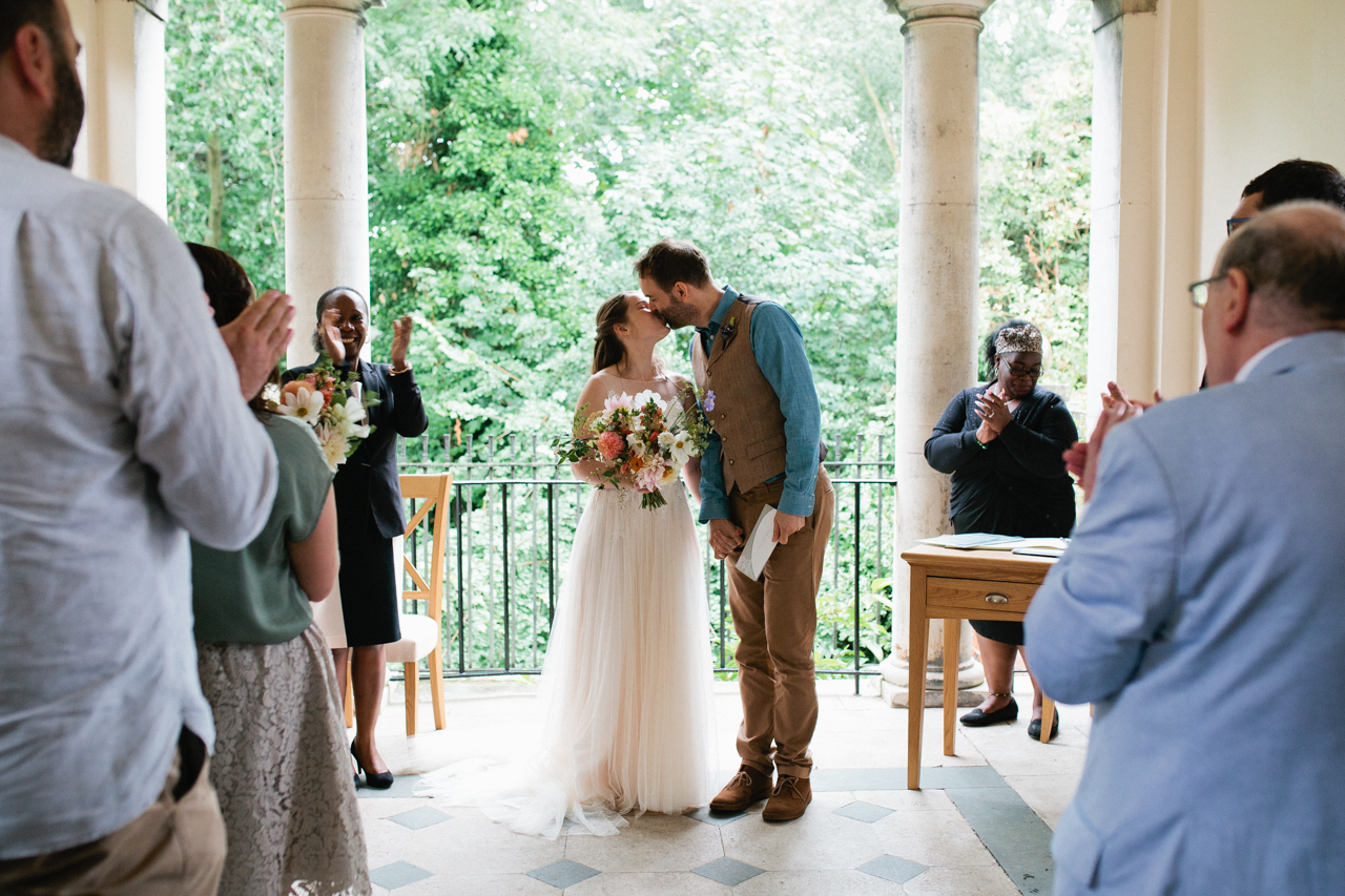 The first kiss at The Hill Top Gardens and Pergola Wedding on Londons Hampstead Heath - Kent documentary wedding photography