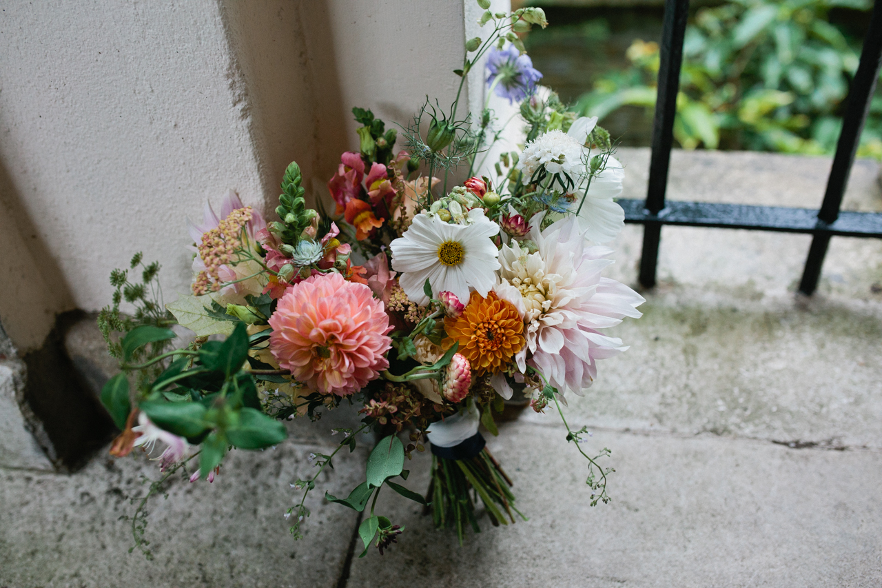 A beauiful and wild flower bouquet at The Hill Top Gardens and Pergola Wedding in London on Hampstead Heath - Kent documentary wedding photography
