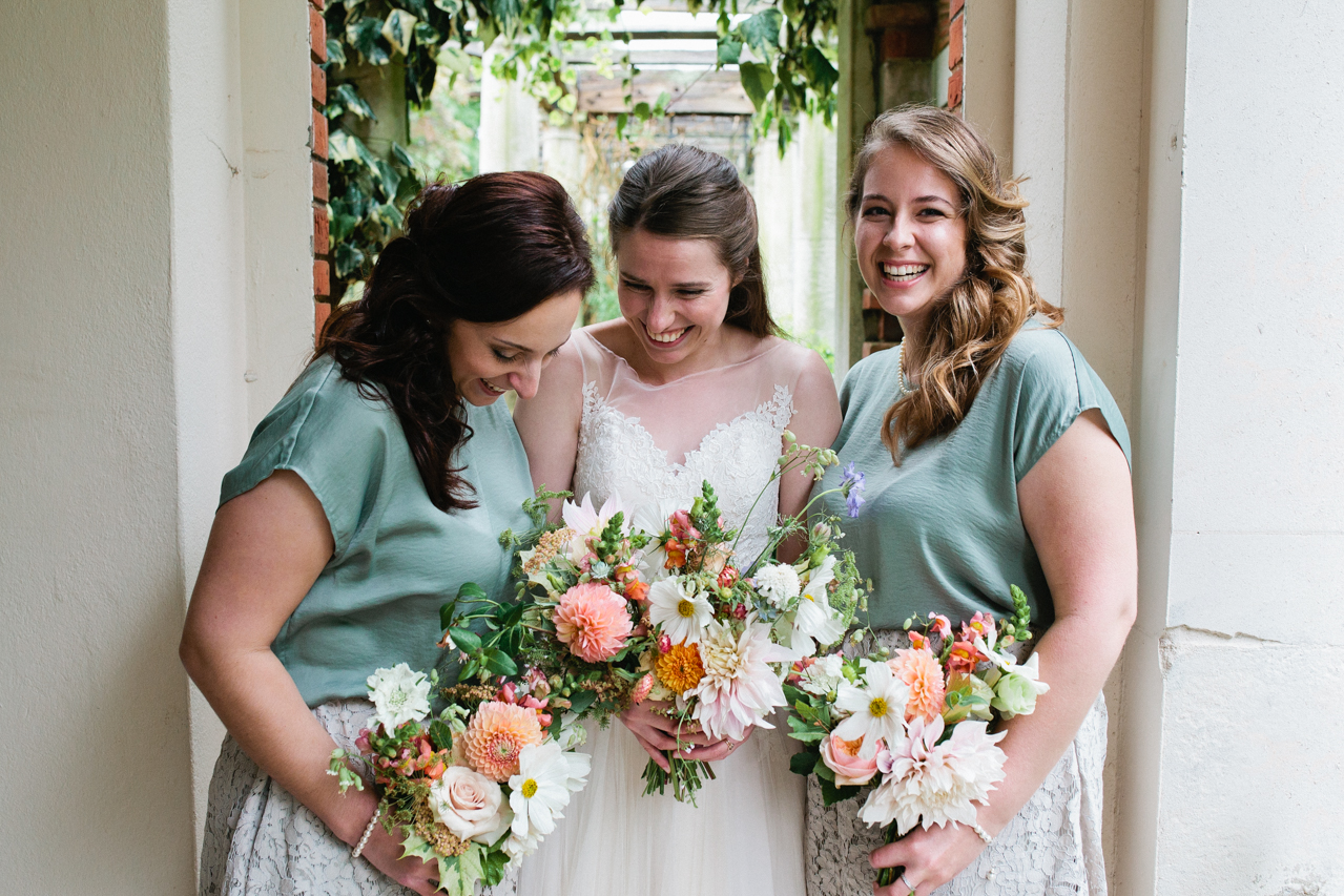 A beautiful and bride and her bridesmaids at The Hill Top Gardens and Pergola Wedding on Londons Hampstead Heath - Kent documentary wedding photography