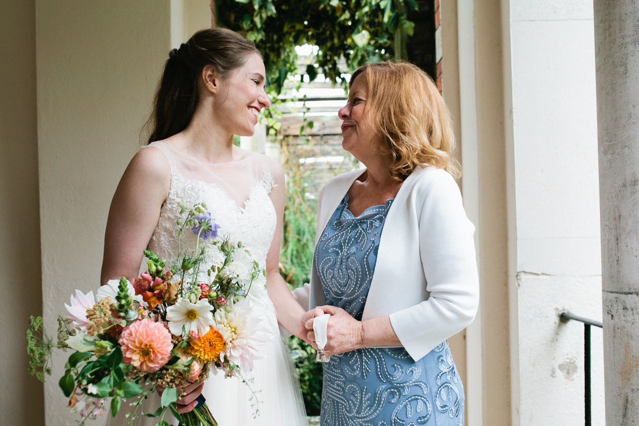 A bride and her mother A beautiful and bride and her bridesmaids at The Hill Top Gardens and Pergola Wedding on Londons Hampstead Heath - Kent documentary wedding photography