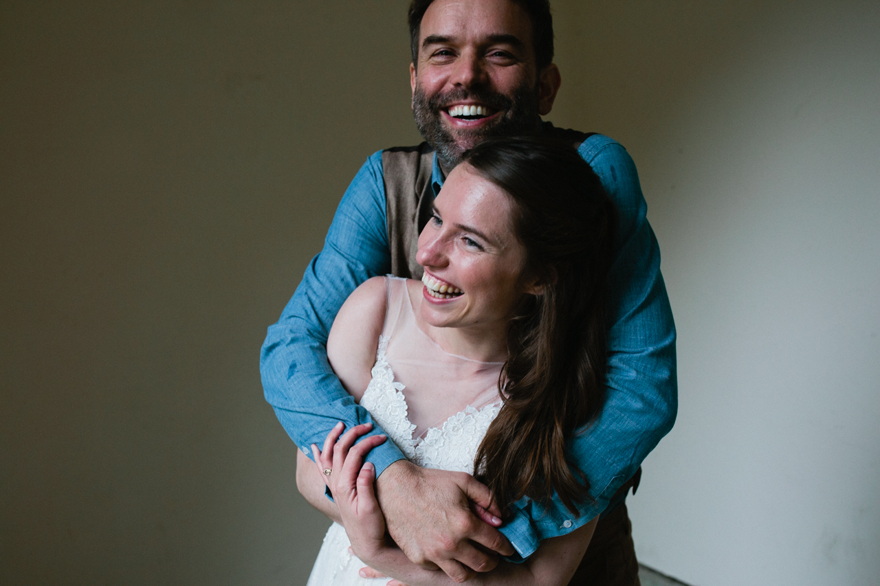 A portraite of a smiling bride and groom A beautiful and bride and her bridesmaids at The Hill Top Gardens and Pergola Wedding on Londons Hampstead Heath - Kent documentary wedding photography