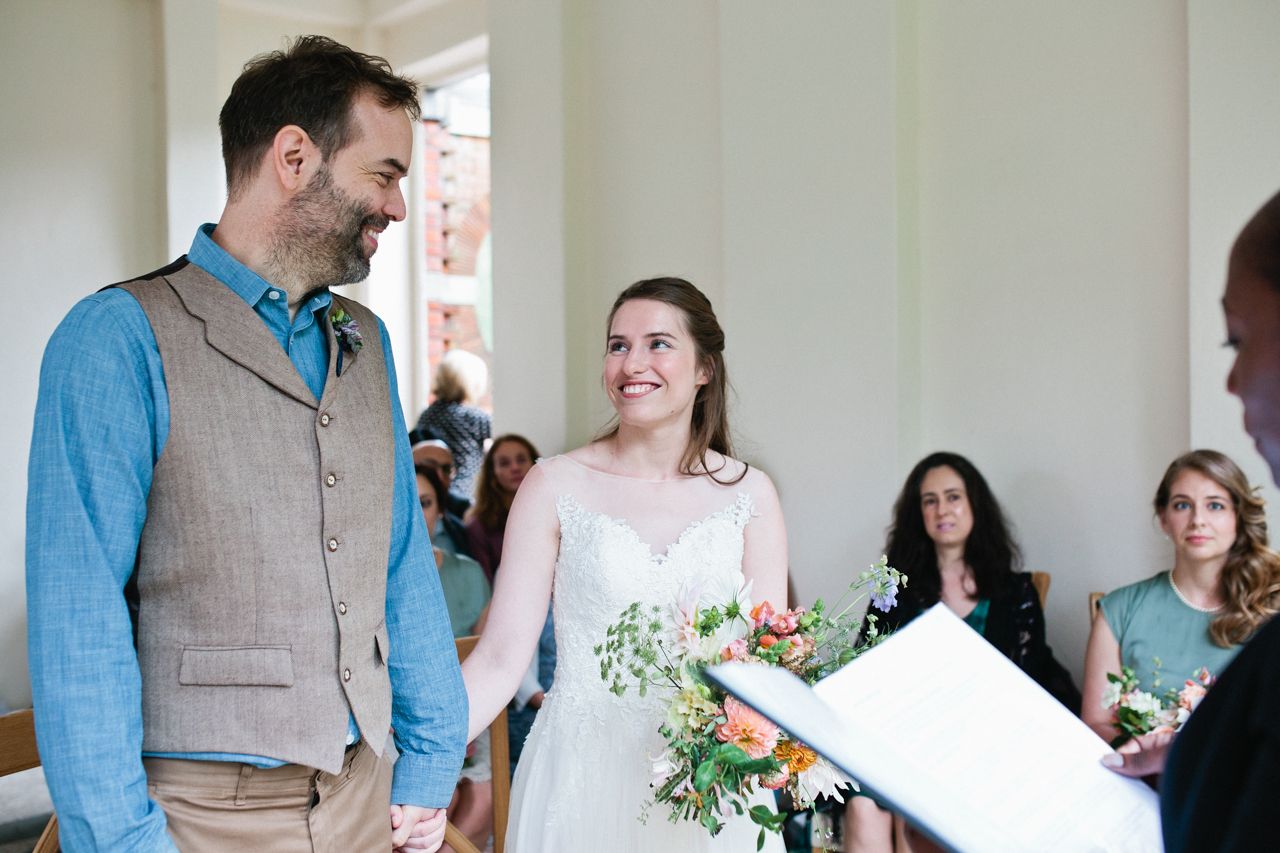 A bride looks up at her groom at The Hill Top Gardens and Pergola Wedding on Londons Hampstead Heath - Kent documentary wedding photography