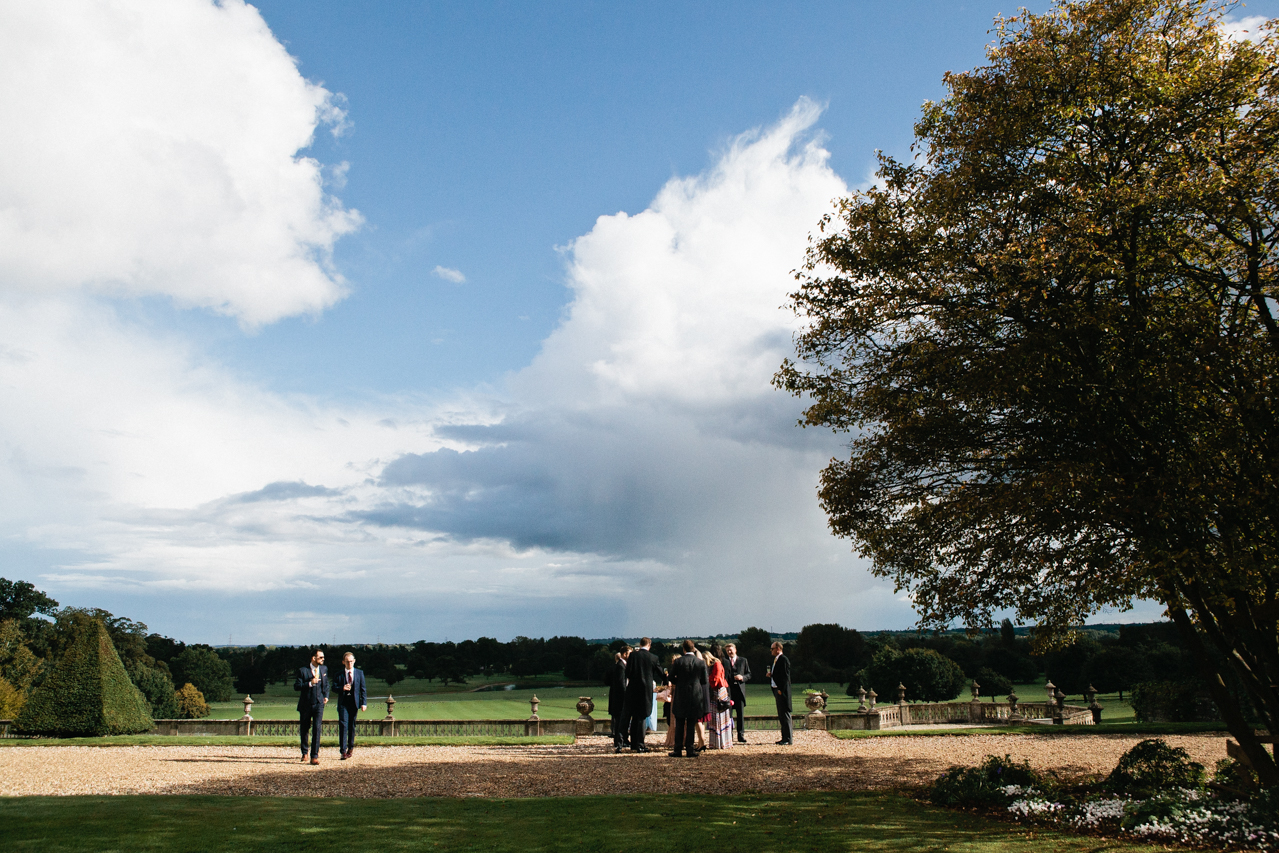 Colour photography of guests enjoying the grounds at an Englefield Estate wedding – Kent Documentary wedding photography