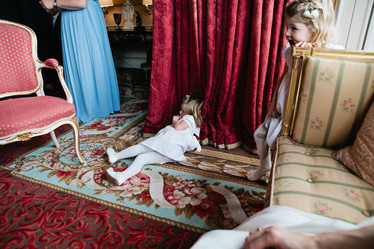Colour photography of a naughty flower girl at an Englefield Estate wedding – Kent Documentary wedding photography