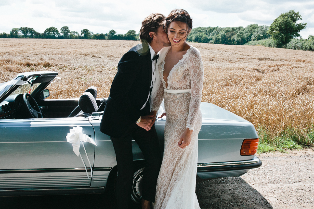 Colour photograph of a groom kissing his gorgeous bride - Kent Documentary wedding photography