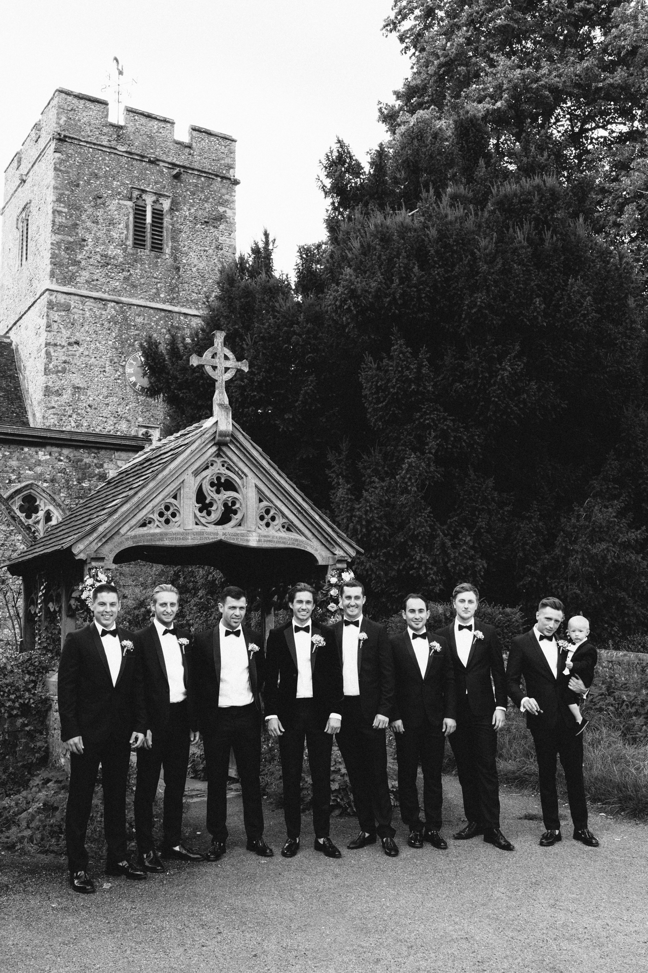 Black and white photograph of a groom and his best man and ushers dressed in black tie - Kent Documentary wedding photography