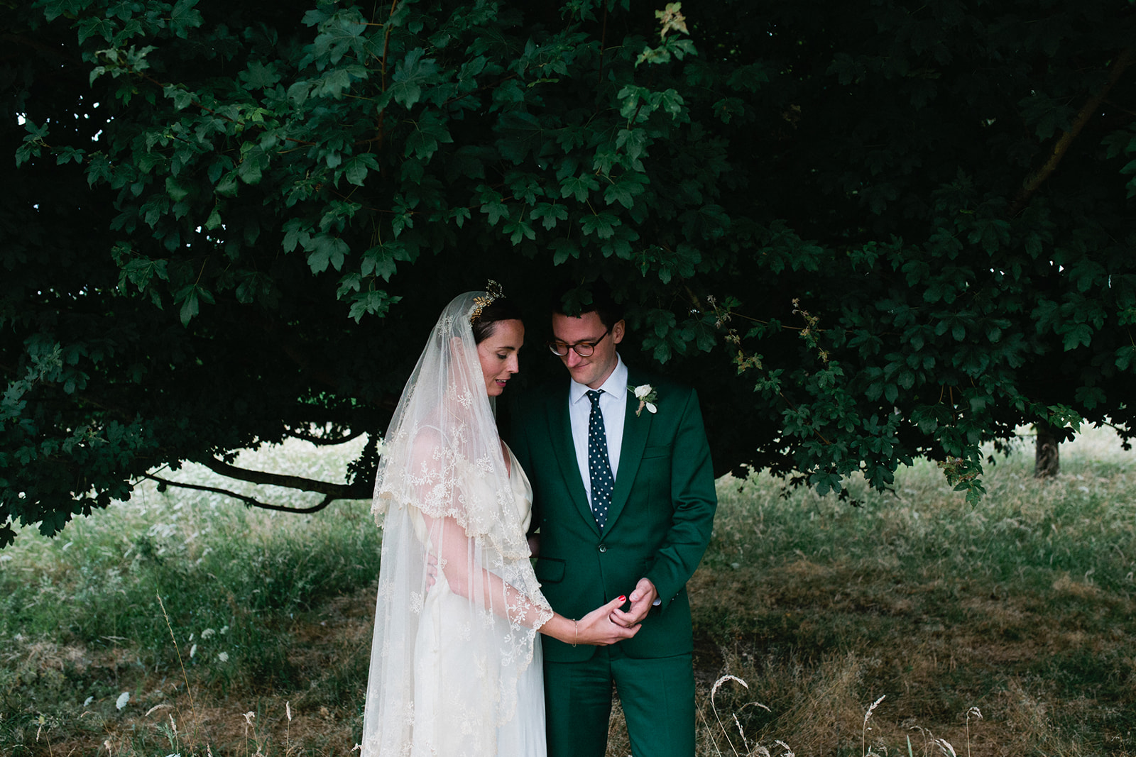 A bride and groom take time for portraits at their Canterbury Marquee Wedding by Matilda Delves who is a Natural Kent Wedding Photographer who photographs in a natural style