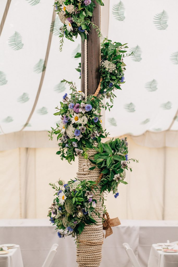 Flowers beautifully decorated a Kent Marquee Wedding near Canterbury photographed by natural style Kent Wedding Photographer Matilda Delves