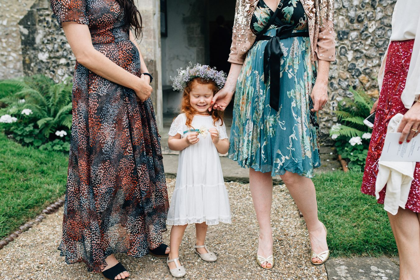 A little flower girl at a church near Canterbury in Kent for a Marquee Wedding photographed by natural style Kent Wedding Photographer Matilda Delves