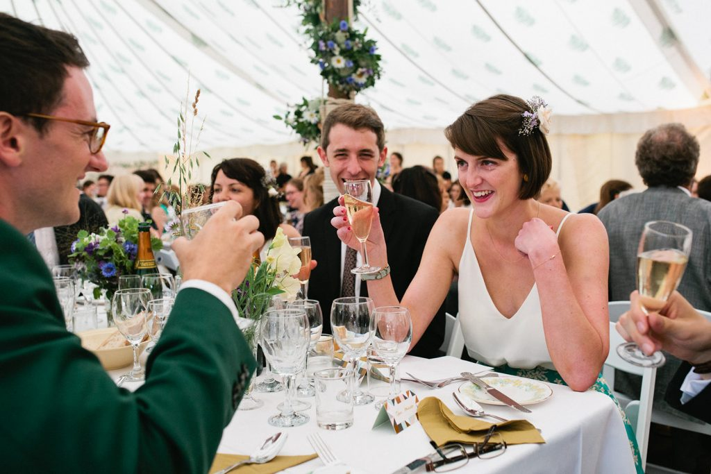 A natural documentary wedding photograph in a marquee by Kent marquee weddings photographer Matilda Delves