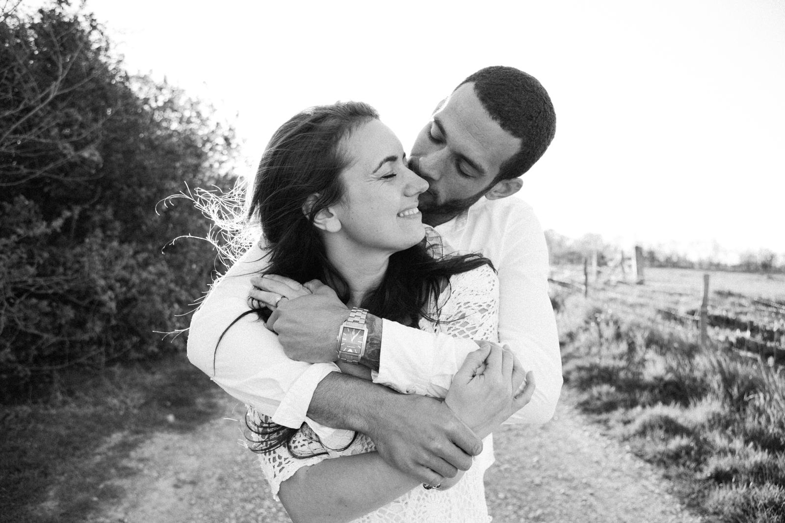 A black and white photo of a couple during an engagement at Sissinghurst Castle by Kent Wedding Photographer Matilda Delves