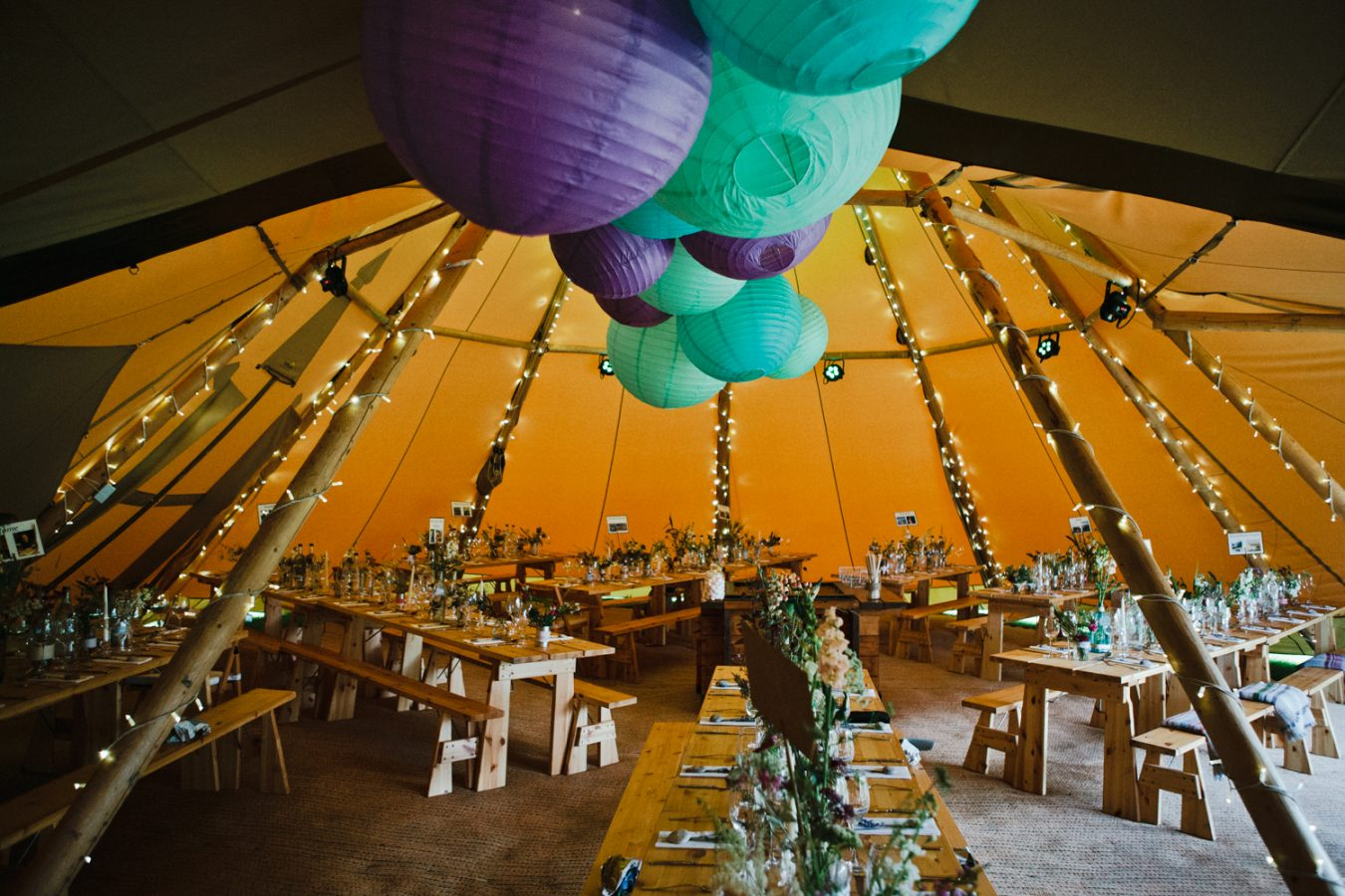 The inside of a beautiful summer Tipi Weddings set up in Kent by Kent Wedding Photographer Matilda Delves