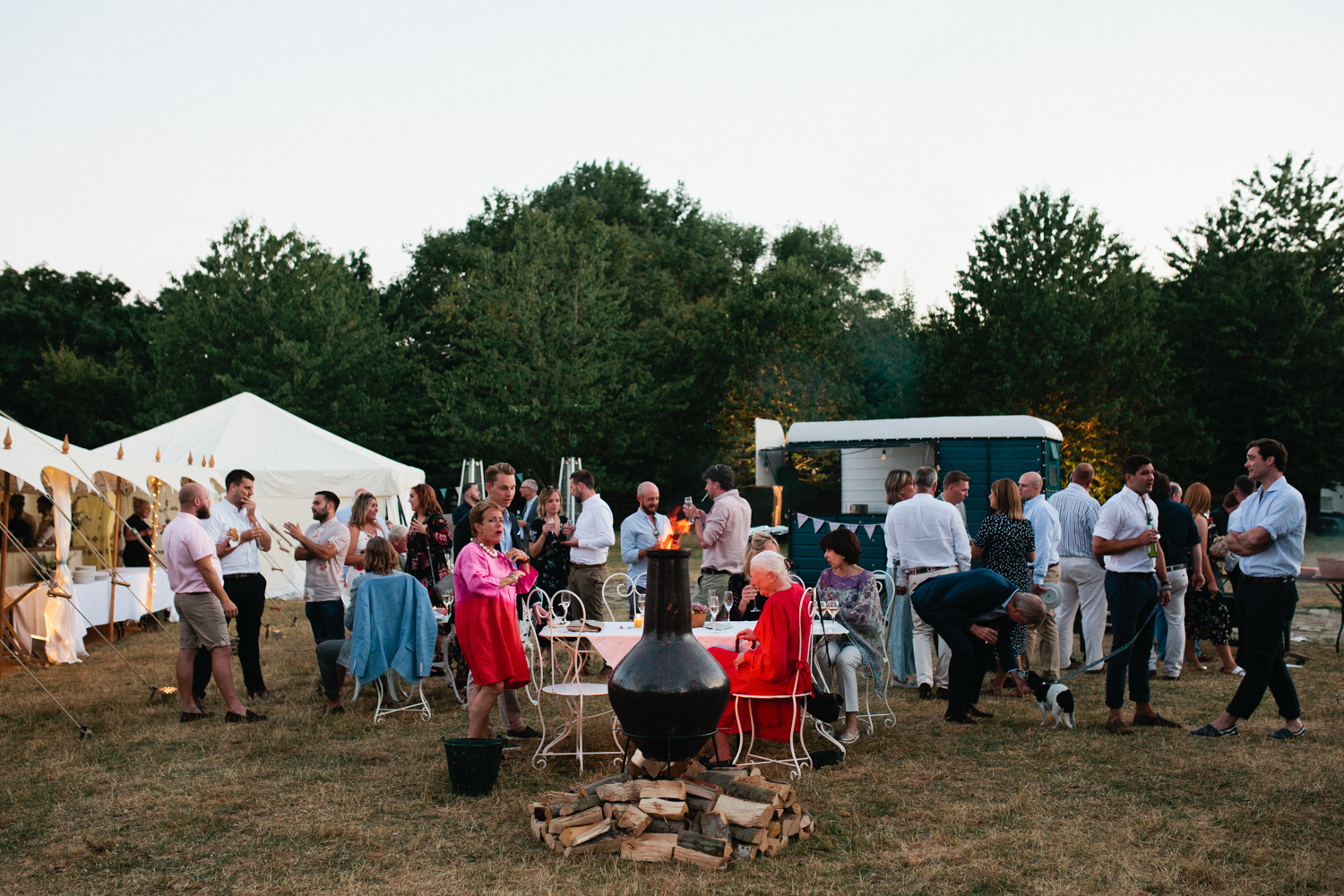 Photograph of wedding guests enjoying an alternative catering idea a a marquee wedding with a House Of Hud Arabian Marquee Tent