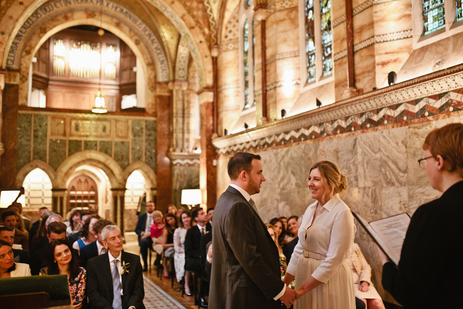 A bride and groom saying their wedding vows in the Fitzrovia Chapel in London photographed by London & Kent Wedding Photographer Matilda Delves