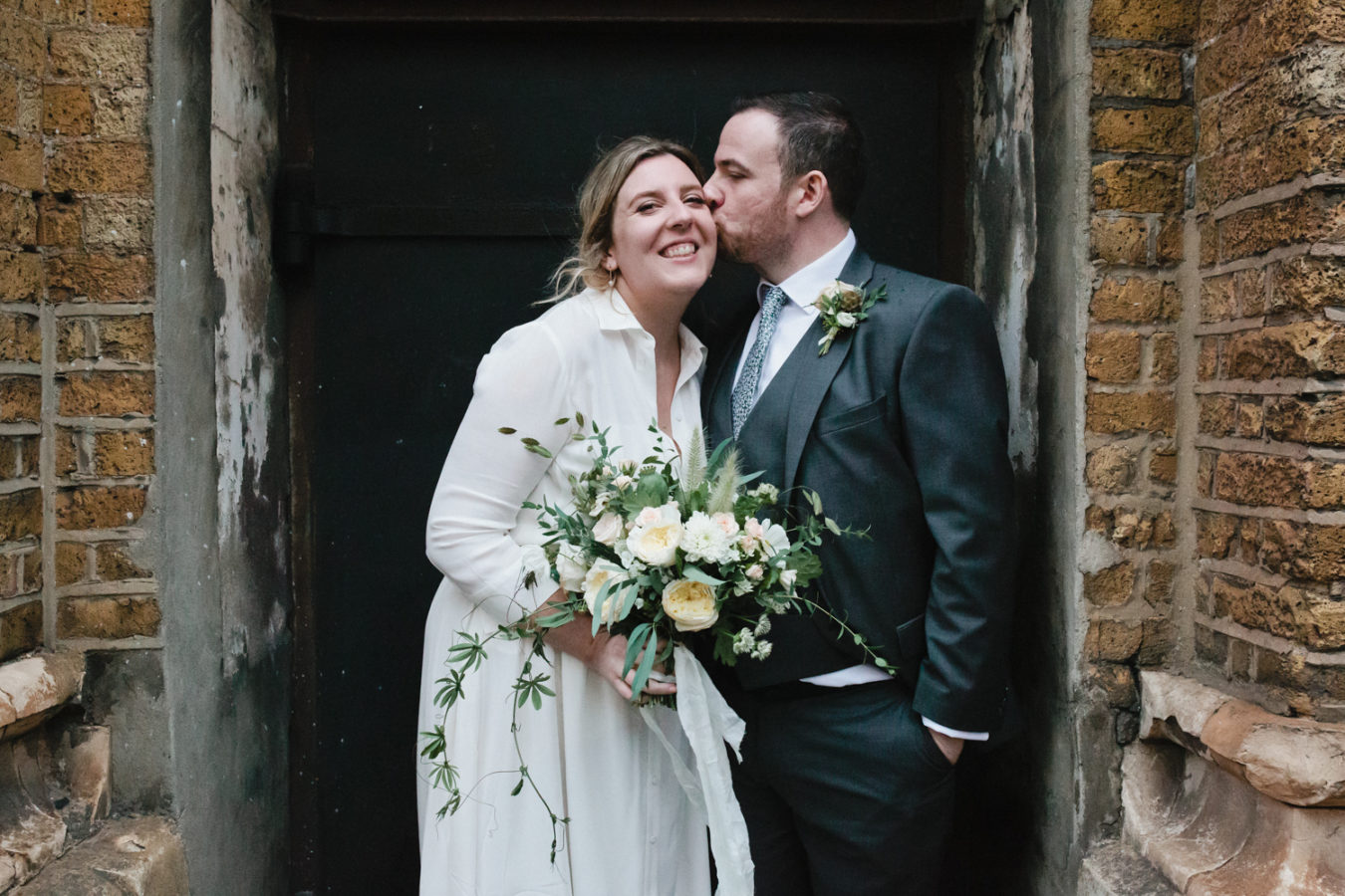A bride and groom outside of the Bermondsey Bar and Kitchen wedding reception photographed by London & Kent Wedding Photographer Matilda Delves