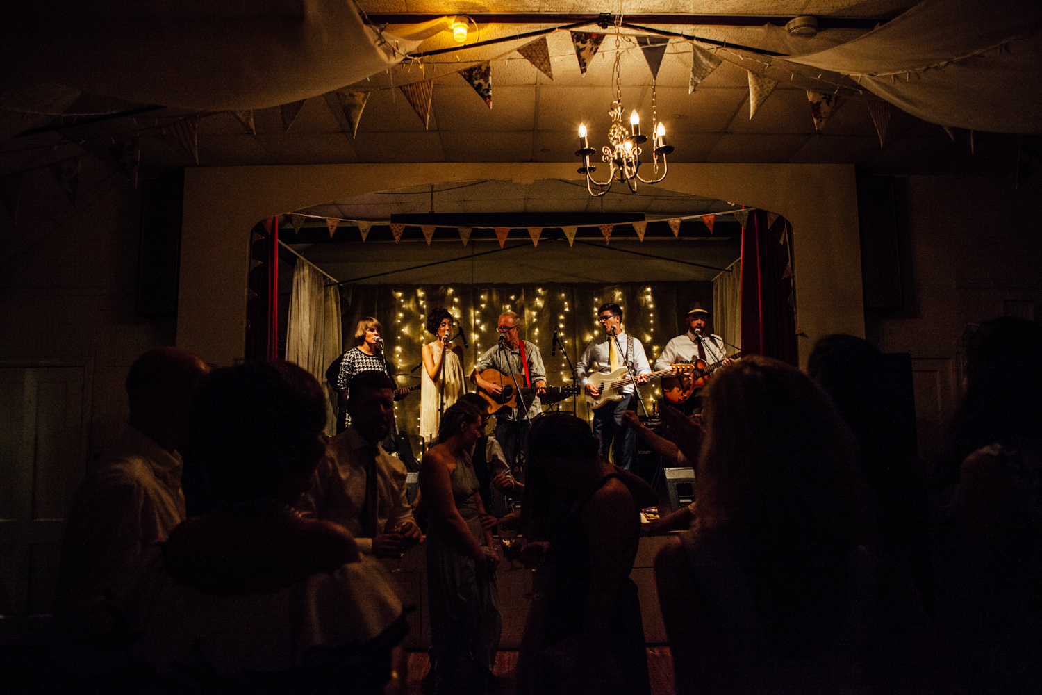 The Band Coco's Lovers play at a festival wedding in this guide on how to plan a festival wedding by Matilda Delves a Kent wedding photographer who specialises in natural wedding photography Kent