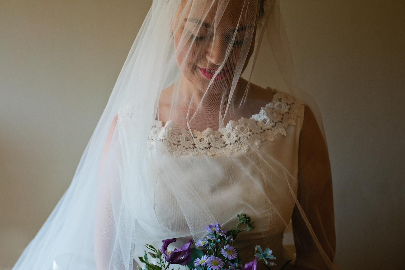 A portrait of a 1950's looking bride at her at their Port Lympne Hotel & Reserve wedding photographed by Kent wedding photographer Matilda Delves