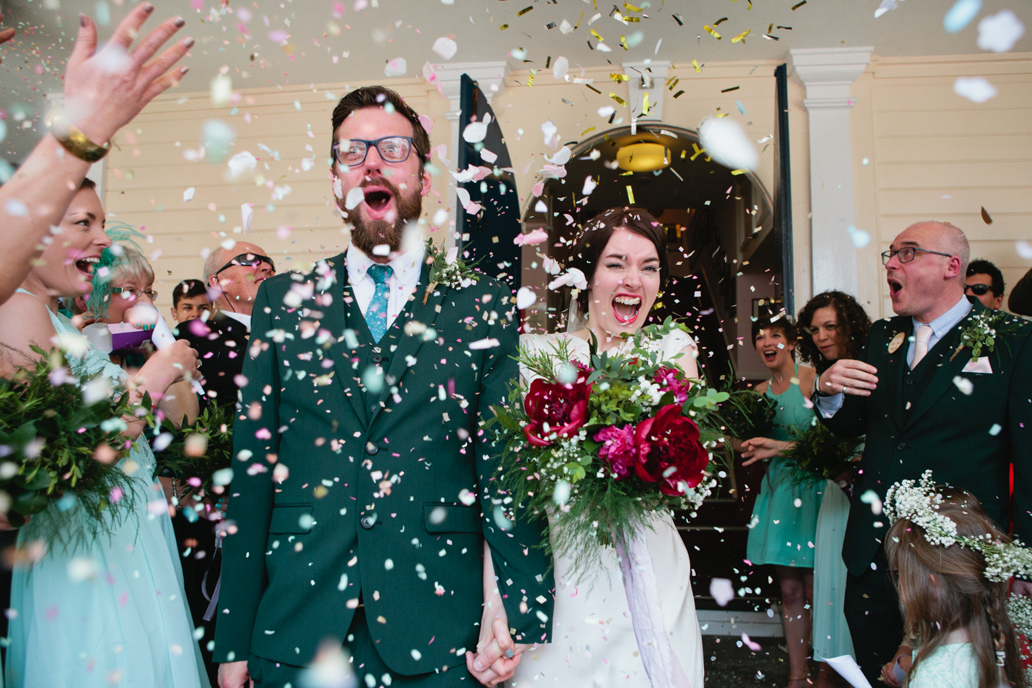 A confetti shot with a confetti canon taken by Natural Kent Wedding Photographer Matilda Delves